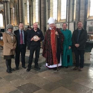 Engagement Director Rich Bee presents the award to the bishop and cathedral staff